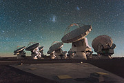 The Atacama Large Millimeter/submillimeter Array (ALMA) by night, under the Magellanic Clouds