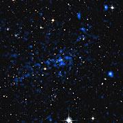 Combinación de vistas con rayos X y luz visible de un cúmulo de galaxias distante