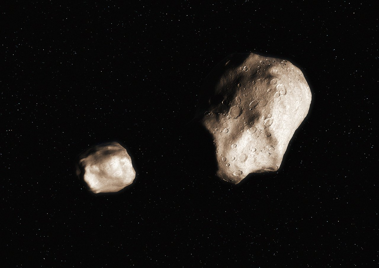 An asteroid that has split due to rotational fission (artist's impression)