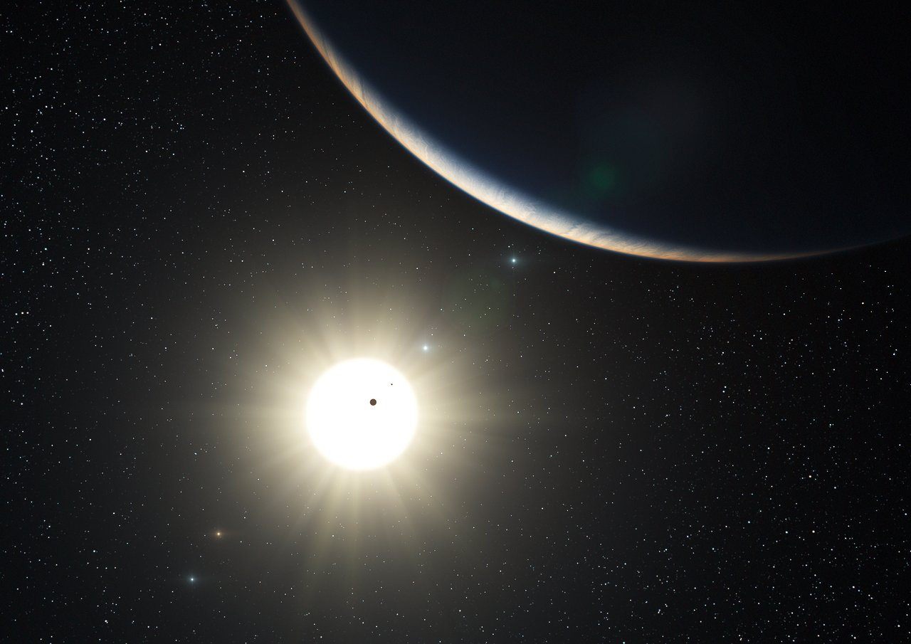 The planetary system around the Sun-like star HD 10180 (artist's impression)