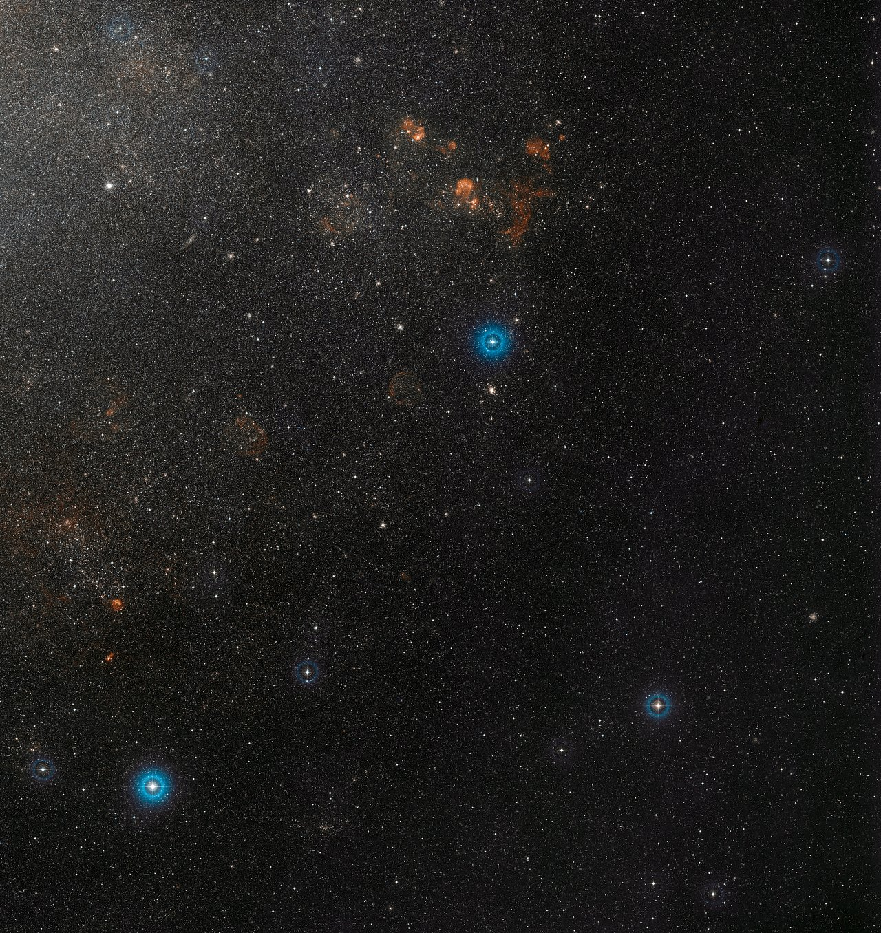 Wide-field view of part of the Large Magellanic Cloud and the remarkable double star OGLE-LMC-CEP0227