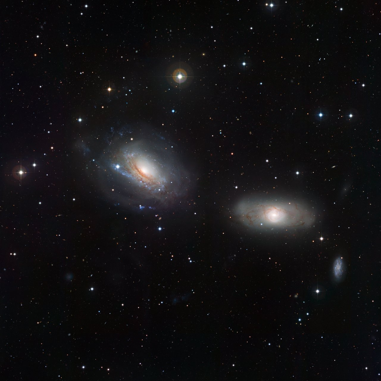 The disturbed galactic duo NGC 3169 and NGC 3166