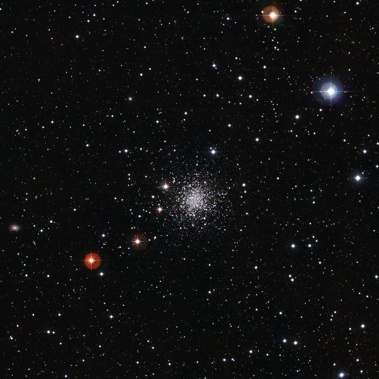 An Ancient Cluster of Stars Against a Stunning Background