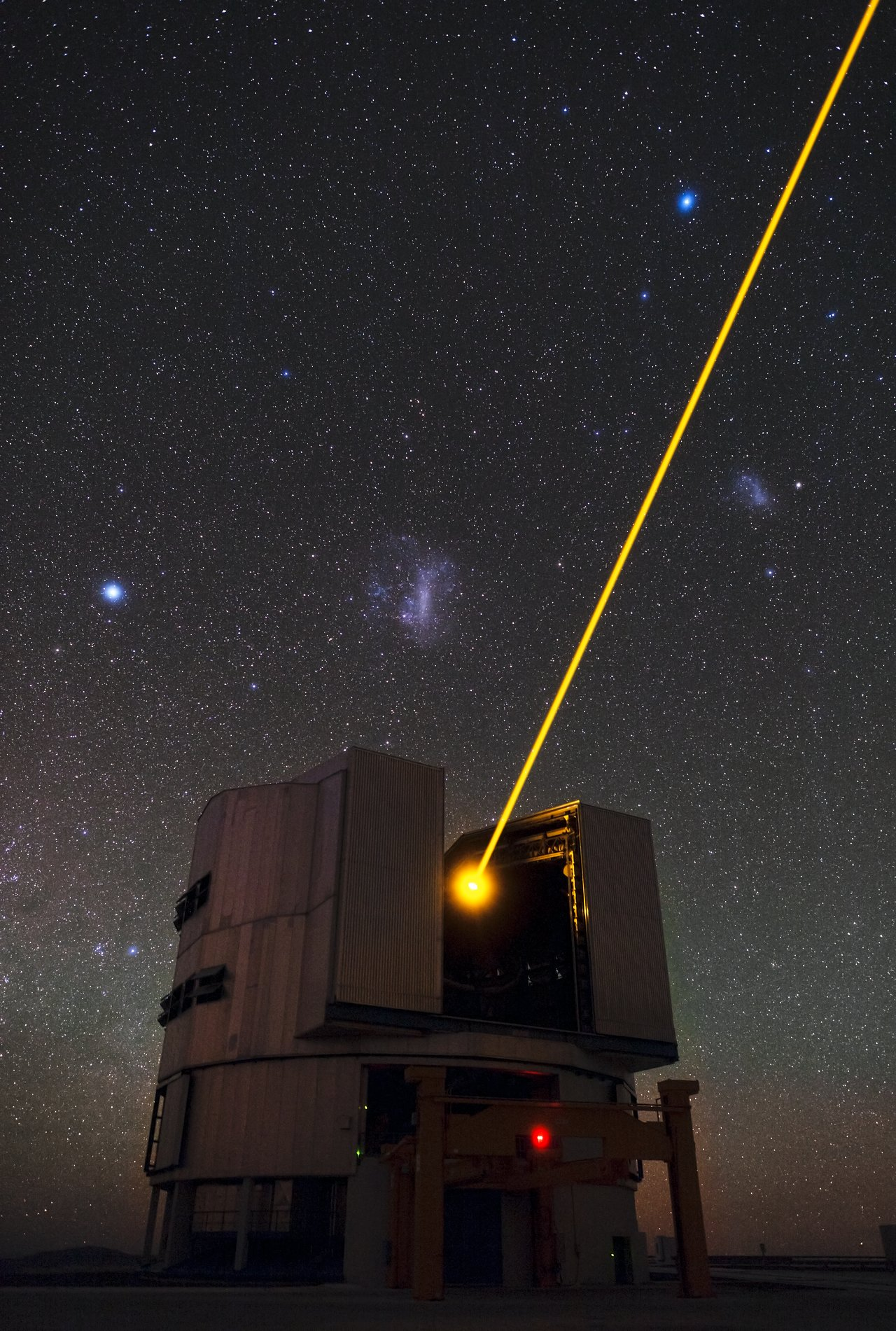 Mounted image 159: Yepun's Laser and the Magellanic Clouds