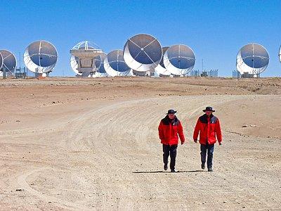 Men in Red Walk Away from ALMA