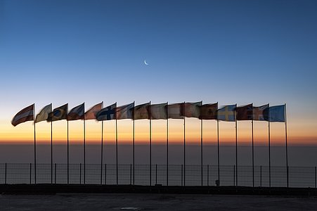 Flags atop Cerro Paranal
