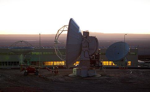 ALMA antennas and OSF at sunset