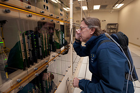 A technician works on the ALMA correlator at 5000 metres elevation