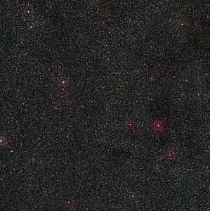 Wide-field view of the sky around the distant active galaxy PKS 1830-211