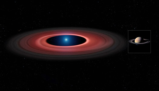 Artist's impression comparing the disc of material around SDSS J1228+1040 and Saturn