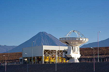 ALMA antenna at OSF, in front of Transporter Shelter and Licancabur volcano