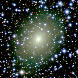 The galaxy ESO 137-10 peeks through a rich curtain of stars