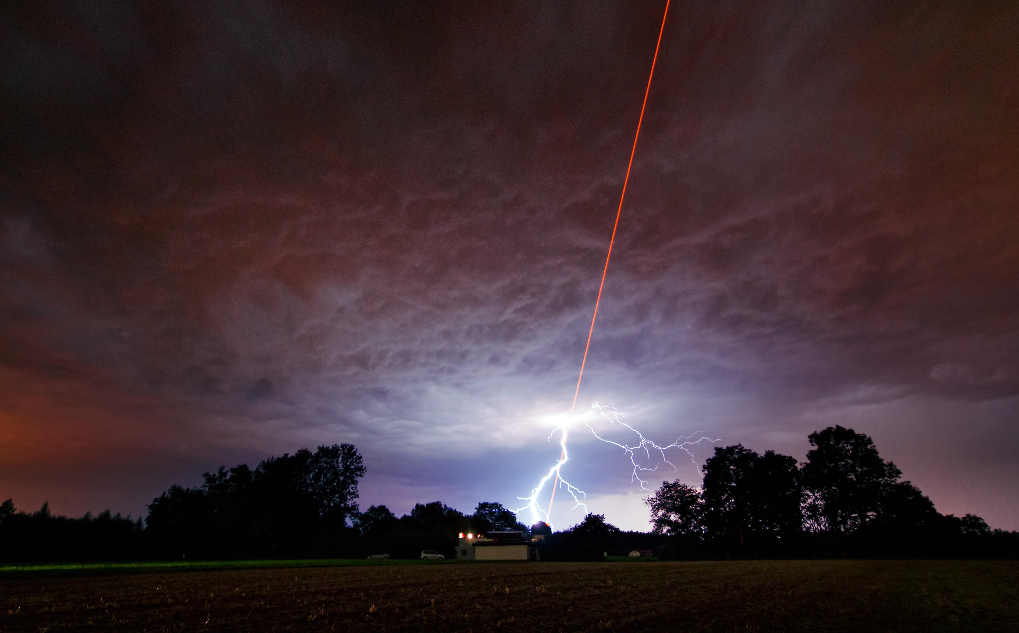 Laser meets lightning | ESO