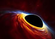 Un trou noir supermassif et une étoile déchiquetée (vue d'artiste)
