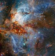 Pestrobarevná nebeská krajina hvězdokupy RCW 38