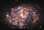 Изображение NGC 1087, полученное на VLT и ALMA на нескольких длинах волн