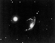 The peculiar galaxy ESO 060-IG26