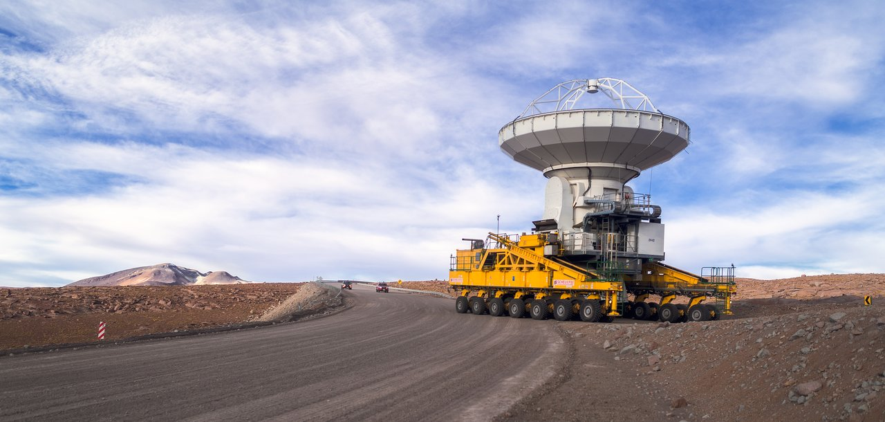 One of the ALMA antennas being transported by one of the antenna transporters.  Credit: ESO/P. Horálek.