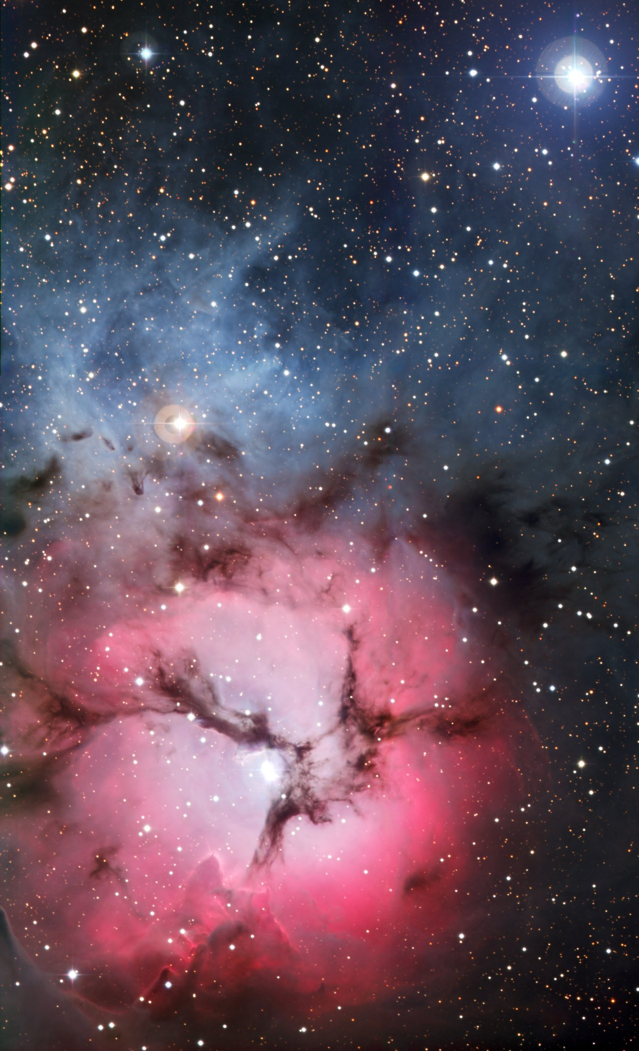 Mounted image 139: Stars are born in the dust-banded Trifid Nebula