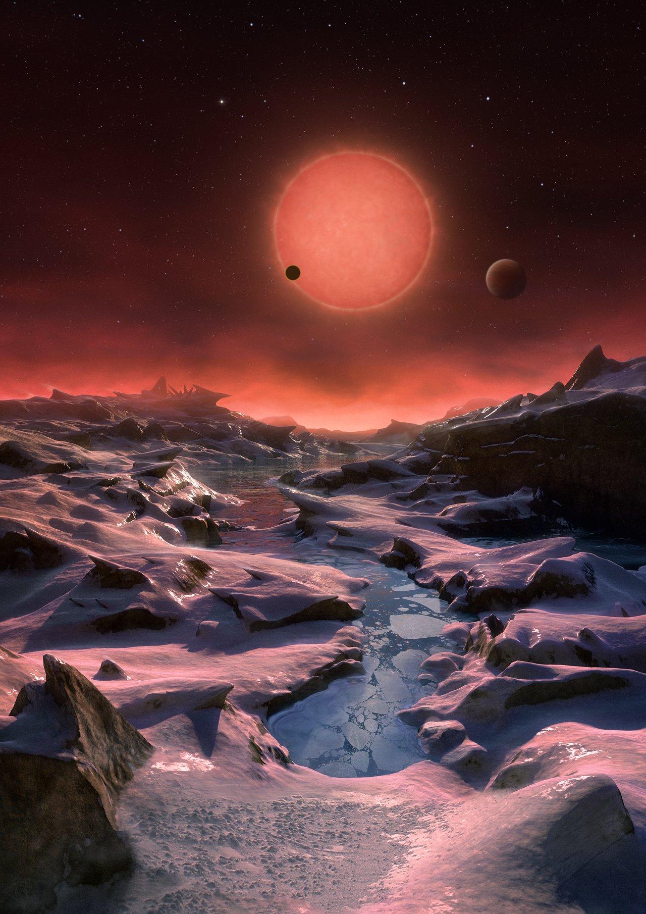 Ilustración de la estrella enana ultrafría TRAPPIST-1 desde la superficie de uno de sus planetas 1 of 5