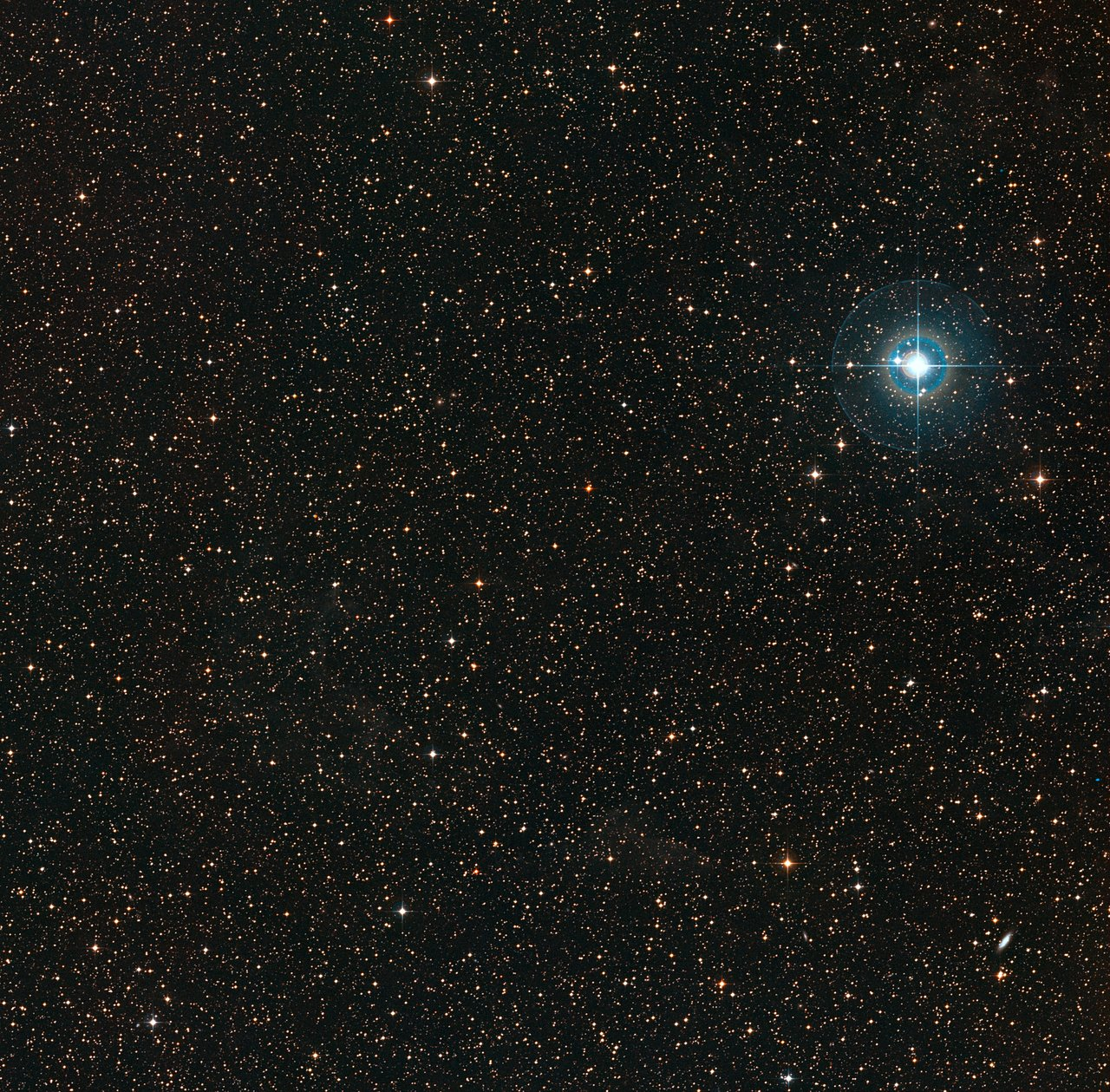 Surrounding environment of the PDS 70 visible in the centre. The bright Chi Centauri star on the right is approximately 510 light years from the Earth.