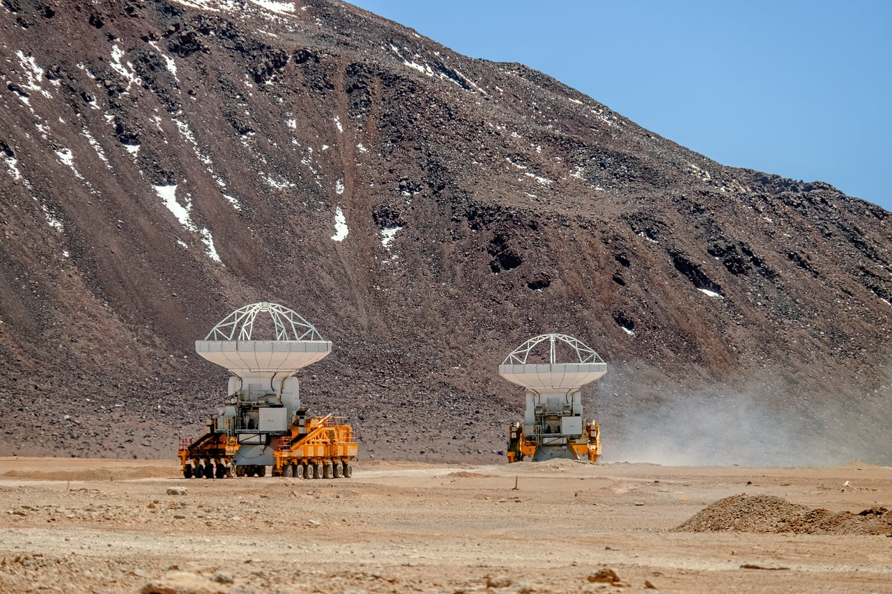 The two ALMA transporters moving antennas.  Credit: A. Russell/ESO.