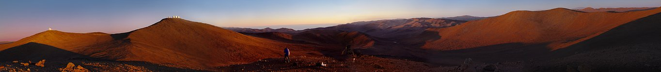 Panoramic view of the desert around the Paranal Observatory at sunset.