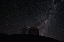 The Milky Way and Alpha and Beta Centauri behind the 3.6-metre telescope at La Silla