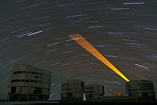Laser Guide Star Sweeps Across a Starry Sky