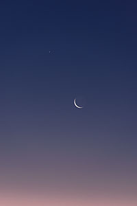 Venus and Mars above the crescent Moon