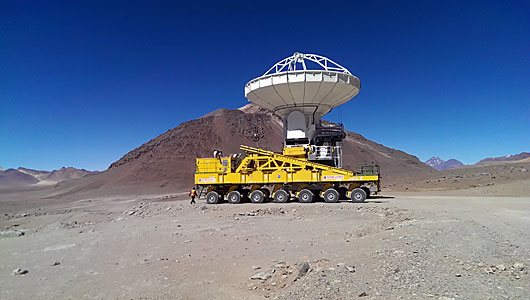 ALMA transporter moving a distant ALMA antenna