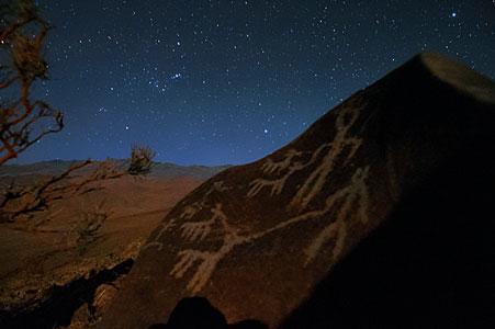 Orion raising over petroglyphs