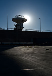 ALMA antenna at OSF backlit by the Sun