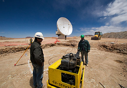 Antenna pad construction work on Chajnantor, in front of an ALMA antenna