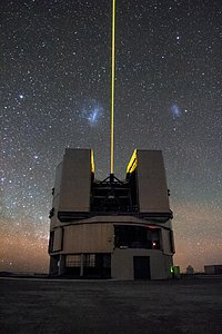 Solitary laser guide star divides the Magellanic Clouds