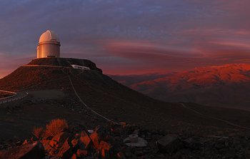 Mounted image 001:La Silla Observatory at sunset with a rare cloudscape