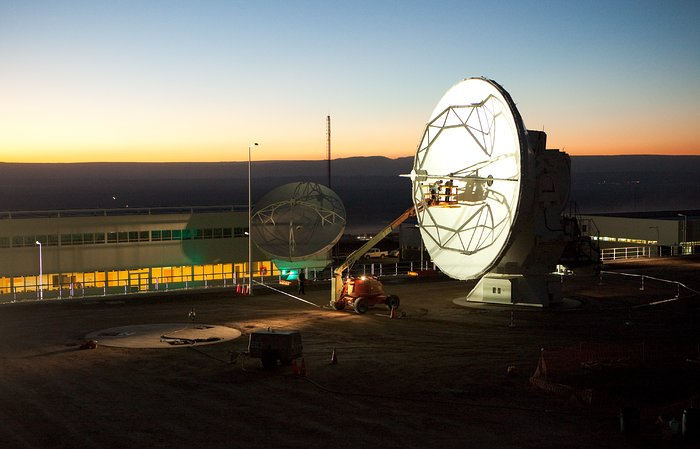 ALMA antennas and OSF at sunset