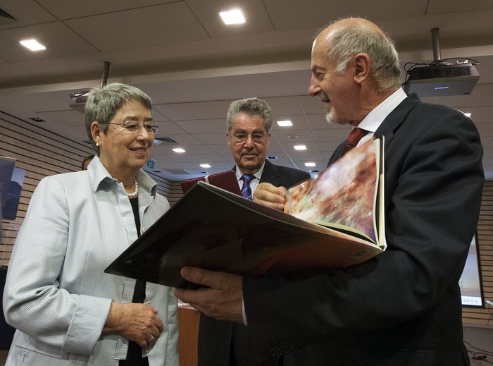 The President of Austria, Heinz Fischer and his wife Margit Fischer are shown the book