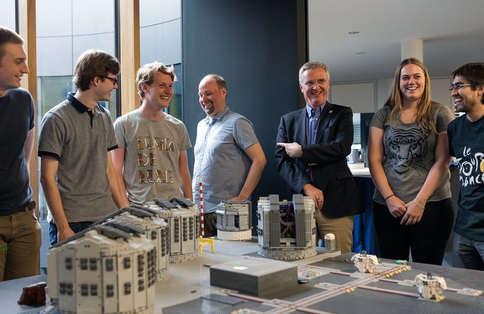 The LEGO® model of the Paranal platform is handed over to ESO's Director General