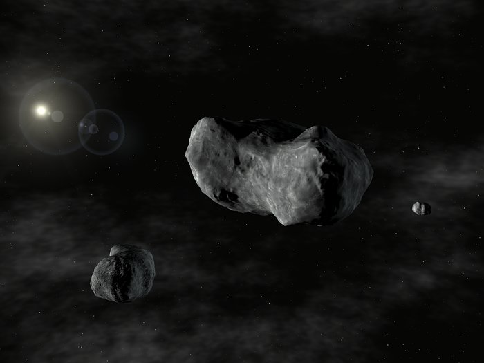 Artist's impression of the triple asteroid system, 87 Sylvia