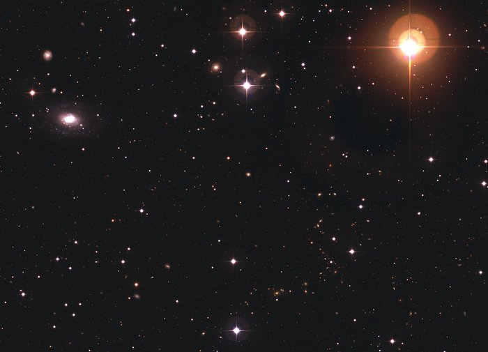 Galaxy ESO 570-19 and Variable Star UW Crateris