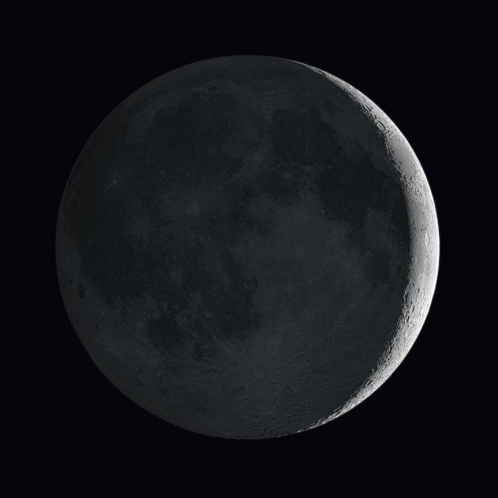 Impresión artística de la Luna mostrando el brillo de la Tierra