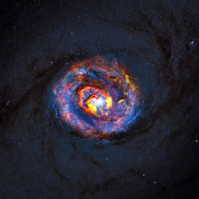 Samsett mynd af vetrarbrautinni NGC 1433 frá ALMA og Hubble