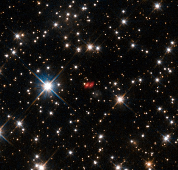 The distant active galaxy PKS 1830-211 from Hubble and ALMA