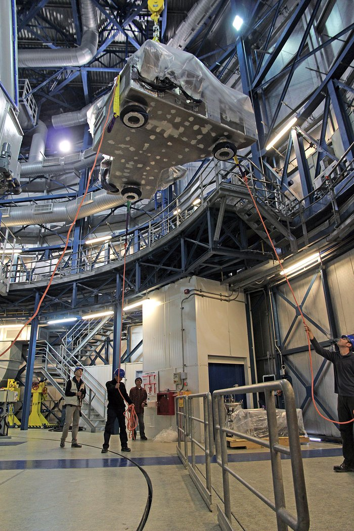 The SPHERE instrument is lifted into the dome of ESO's VLT Unit Telescope 3