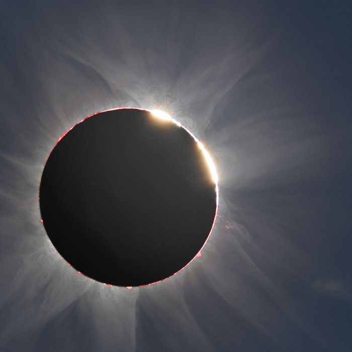 The double-diamond-ring effect seen during the hybrid solar eclipse of 3 November 2013