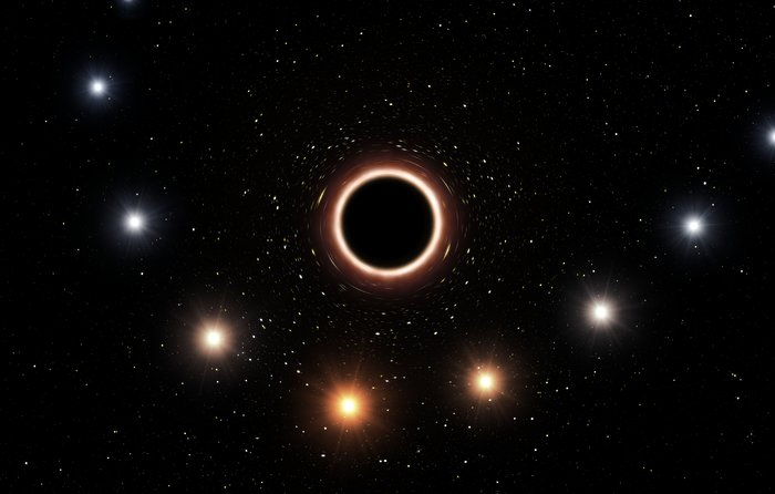 Artist's impression of S2 passing supermassive black hole at centre of Milky Way