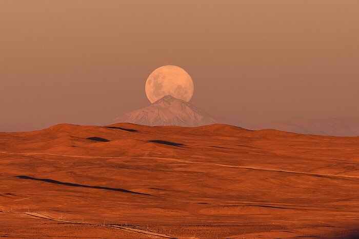 The Moon Behind the Mountain