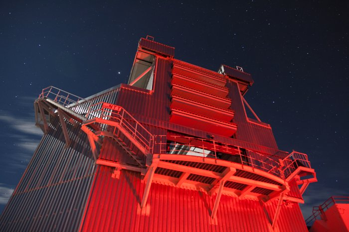 New Technology Telescope bathed in red