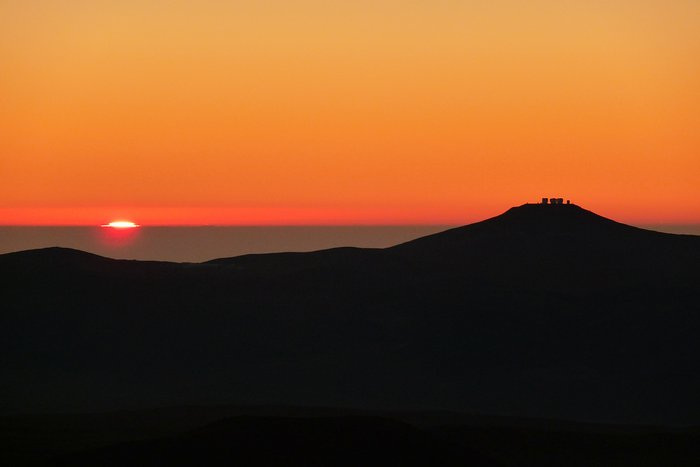 A view of Paranal at sunset from Armazones